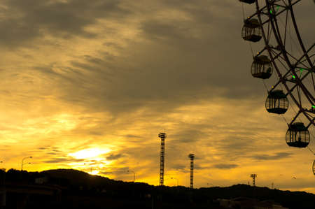 acrophobia: Silhouette of ferris wheel at sunset in japan