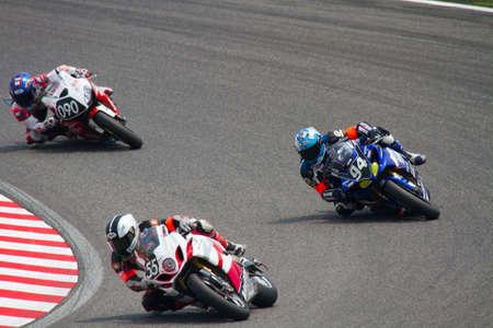 third wheel: SUZUKA, JAPAN - July 31 : Rider of YAMAHA FRANCE GMT94 MICHELIN YAMALUBE (third place team) racing at 2011 Suzuka 8 hours World Endurance Championship Race, on July 31, 2011 in Suzuka Circuit, Japan. Editorial