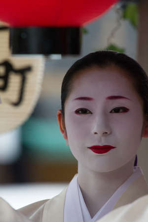 maiko: KYOTO - JULY 24: Unidentified Maiko girl (or Geiko lady) on parade of hanagasa in Gion Matsuri (Festival) held on July 24 2013 in Kyoto, Japan. It is one of Kyotos renowned three great festivals.  Editorial