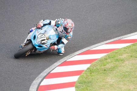 cornering: SUZUKA, JAPAN - July 28 : Rider of Team KAGAYAMA (3rd place team. Kevin Schwantz and Noriyuki Haga belongs) racing at Suzuka 8 hours World Endurance, on July 28, 2013 in Suzuka Circuit, Japan.