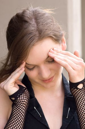 apparent: Pretty teen girl with apparent headache or massaging her forehead Stock Photo
