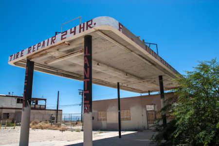 An abandoned garage and gas station near Salton Sea, a shallow, saline, endorheic rift lake located directly on the San Andreas Fault