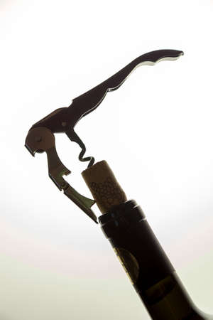 Opening a bottle of wine with cork