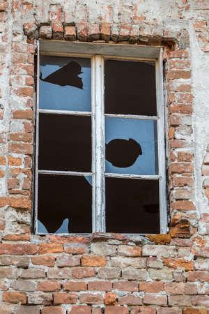 vandal: abandoned broken windows Stock Photo