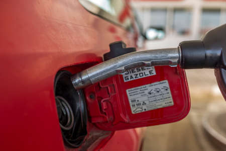Fuel nozzle to refill fuel in car at gas station Stock Photo