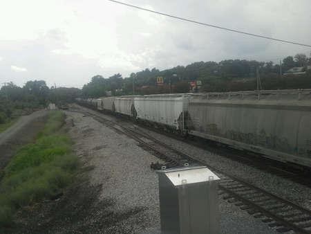 va: Freight train going beneath the pedestrian bridge I am on over the tracks in downtown Altavista,VA