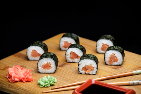 Classic sushi roll with salmon, healthy snack. Seafood meal perfect source for omega.