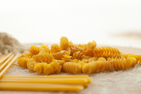 Top view on raw homemade pasta with flour, gluten free. Special pasta for people on a diet, organic food. Stockfoto