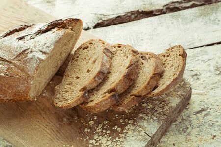 Sliced homemade gluten free bread on cutting board. Healthy lifestyle with organic diet product. Stockfoto
