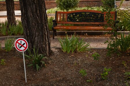No smoking sign in public park to warning people. Concept of healthy lifestyle for everyone as right in public.