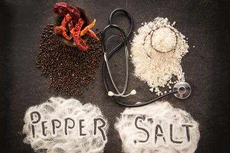 Pepper and salt brings harm to health. Concept of healthy lifestyle, special diet for sick people.