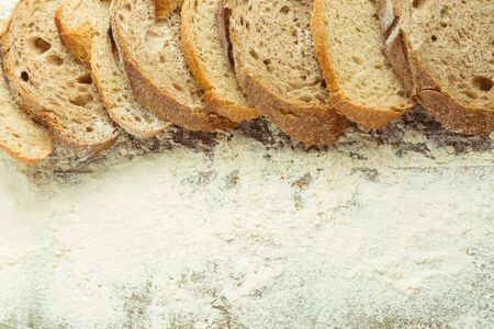 Sliced loaf of different kind homemade bread. Free space for recipe of gluten free bread. Healthy lifestyle concept.