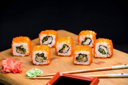 Tasty california sushi roll with shrimps and cucumber. Healthy japanese meal with low calories.