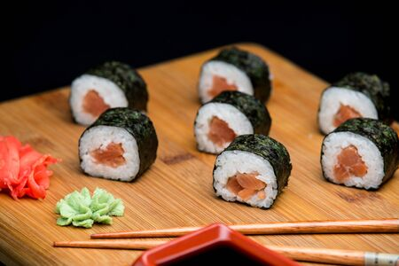 Traditional japanese sushi with fresh salmon, low calories food. Healthy lifestyle with natural meal.