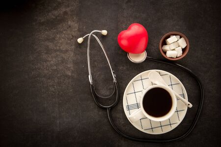 Concept of harm that brings dark coffee and sugar. Reasons of heart attack.