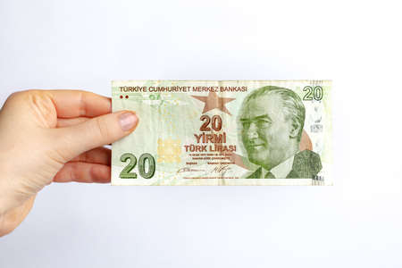 Turkish lira banknotes in womans hand. Concept of pandemic crisis after quarantine, falling of Exchange Rates