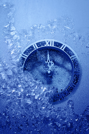 horologe: Blue frostwork background and clock indicative approach of New Year Stock Photo