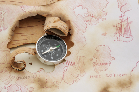 disrepair: Old dingy chart of North Europe and compass