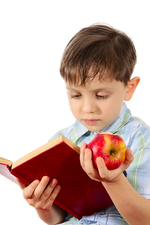 able to learn: The little boy the infant-prodigy with apple, reading the book