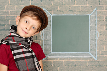copy spase: Schoolboy before the open window represented on a chalkboard Stock Photo