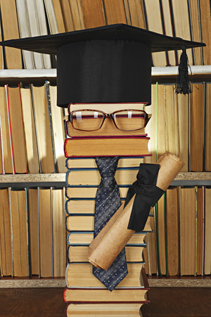 master volume: Education concept. Forged student from books in library Stock Photo