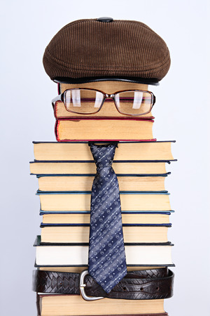 Burlesque image of the intellectual: books, eyeglasses, a necktie