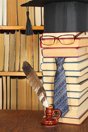 master volume: Unusual joky parody. Student with quill in library Stock Photo