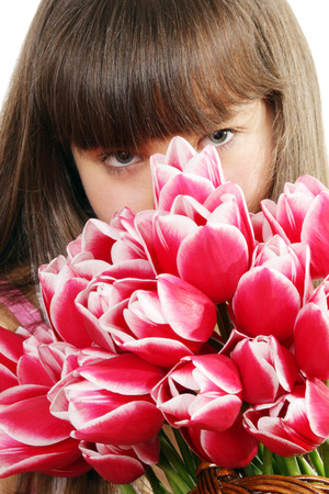Portrait of girl with large bouquet of flowers photo