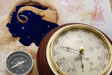 Abstract. Astral sky in hole of old chart. Compass and barometer Standard-Bild