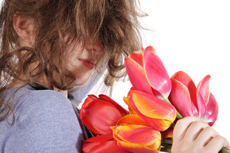 The disheveled girl with a bouquet of flowers
