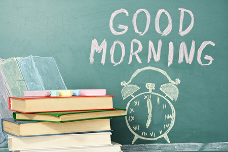 reveille: Good morning! Chalk drawing of books, alarm clock and writing wish. Education concept.