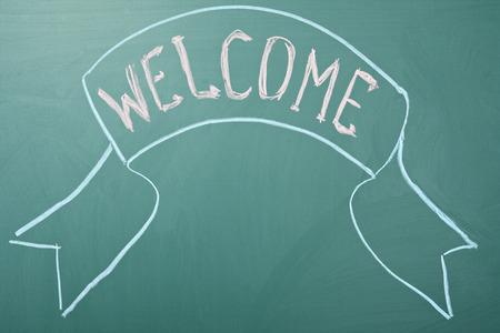 Welcome. Greeting on a blackboard