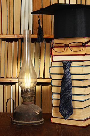 The student with petroleum lamp at night in library. Fun image