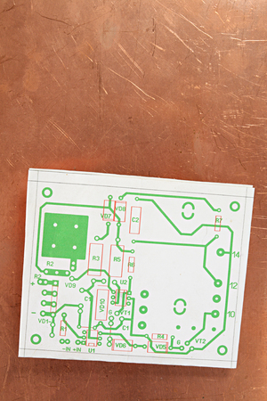 Drawing of electronic board on copper background from metal-clad glass textolite photo