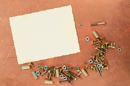 copper coated: Copy space for photograph on a copper background with screwes and screw-nuts