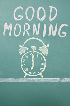 reveille: Good morning! Chalk drawing of alarm clock and writing wish. Education concept