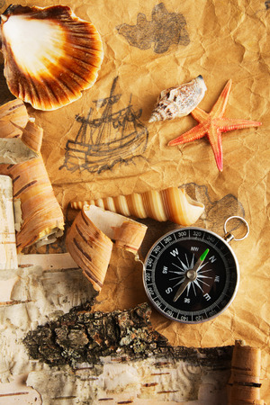 disrepair: Antique map, shell, starfish and compass Stock Photo