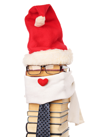 Unusual Santa Claus from books isolated on a white background. HAPPY NEW YEAR! photo