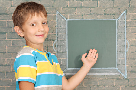 copy spase: The schoolboy showing on the open window drawn on a chalkboard Stock Photo