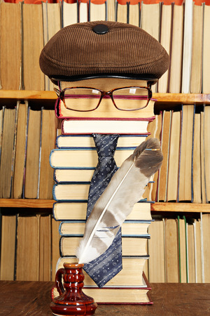 Unusual funny parody.Teacher with quill pen in library Standard-Bild