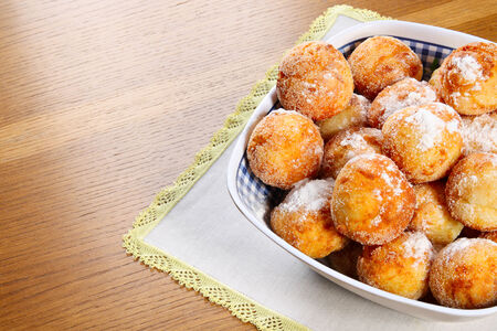 auroral: Cheese cakes in sugar powder on a table Stock Photo