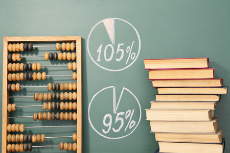business education: Education concept. Books, abacus and diagrams showing success