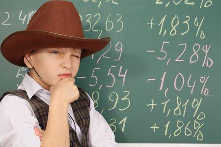 Boy as a trader in cowboy hat Standard-Bild