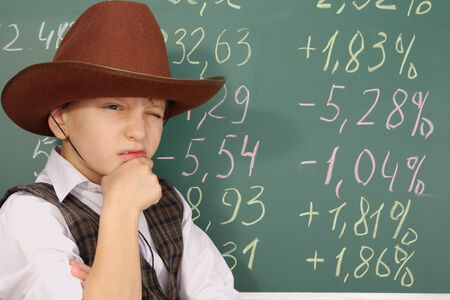 Boy as a trader in cowboy hat Banco de Imagens