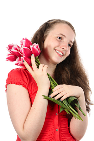 The happy smiling girl in red blouse with flowers. Isolated on white