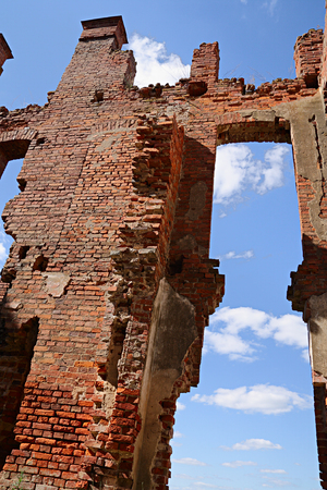 detritus: Ruins of old building on background of sky Stock Photo