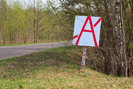 stay on course: Original sign of bus stop on country road in a wood