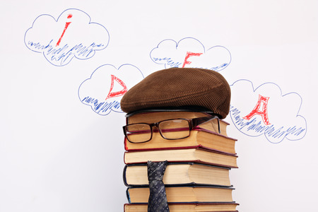 parody: Unusual student parody on a background of idea word in clouds