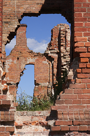 venerable: Breach in a brick wall of an ancient building Stock Photo