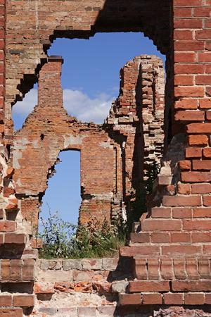 breach: Breach in a brick wall of an ancient building Stock Photo